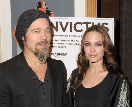 Brad Pitt and Angelina Jolie at a benefit dinner