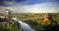 Suspension Bridge with balloons in background
