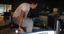 Mike Conway getting into the racing simulator