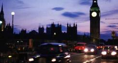 London at night with Big Ben and cars