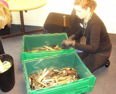 teams sort through hundreds of knives