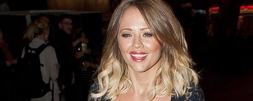 Kimberley Walsh wearing a tight black dress