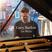 Image 9: Gary Barlow plays piano