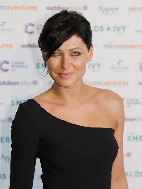 emma willis in an off the shoulder black dress