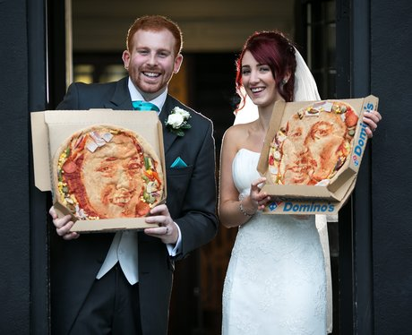 Kieran and Natasha Morris on their wedding day with their pizza selfies