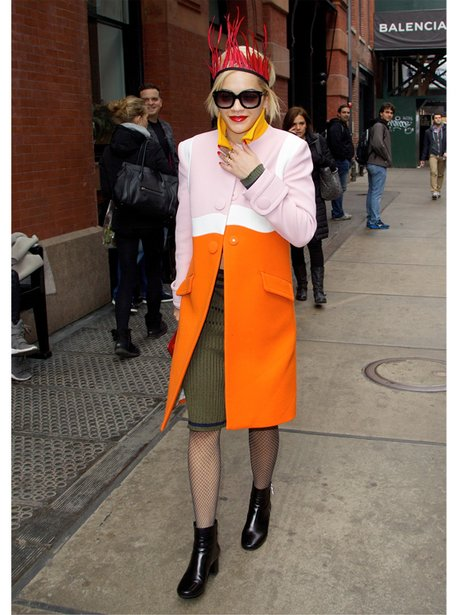 Rita Ora in an orange and pink coat in Soho NYC