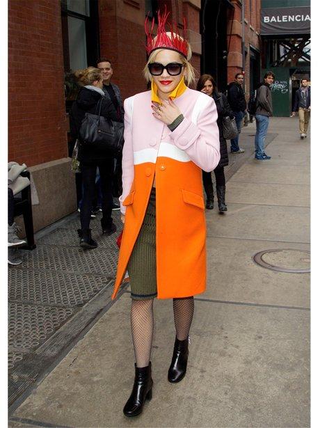 Rita Ora in an orange and pink coat in Soho NYC