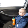 A baby sitting in a car
