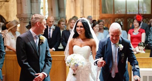 Phil Lawrence walking his daughter down the aisle.