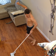 topless man hoovering