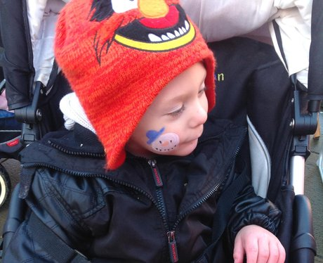 boy with snowman painted on his face