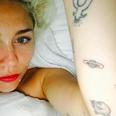 Miley Cyrus new 'Jupiter' planet arm tattoo