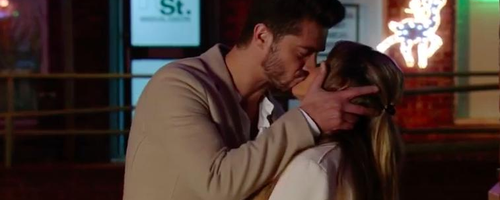 Corrie Maria and Adam Kissing